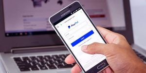 PayPal On Smartphone And Laptop