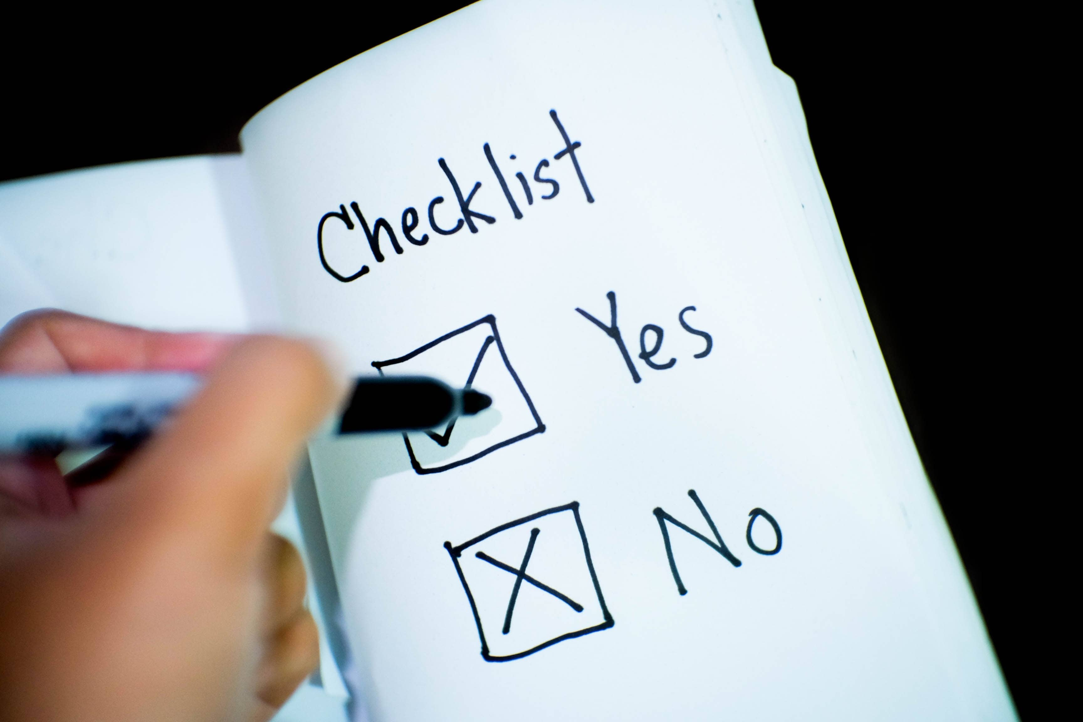 Person With Pen Writing Checklist