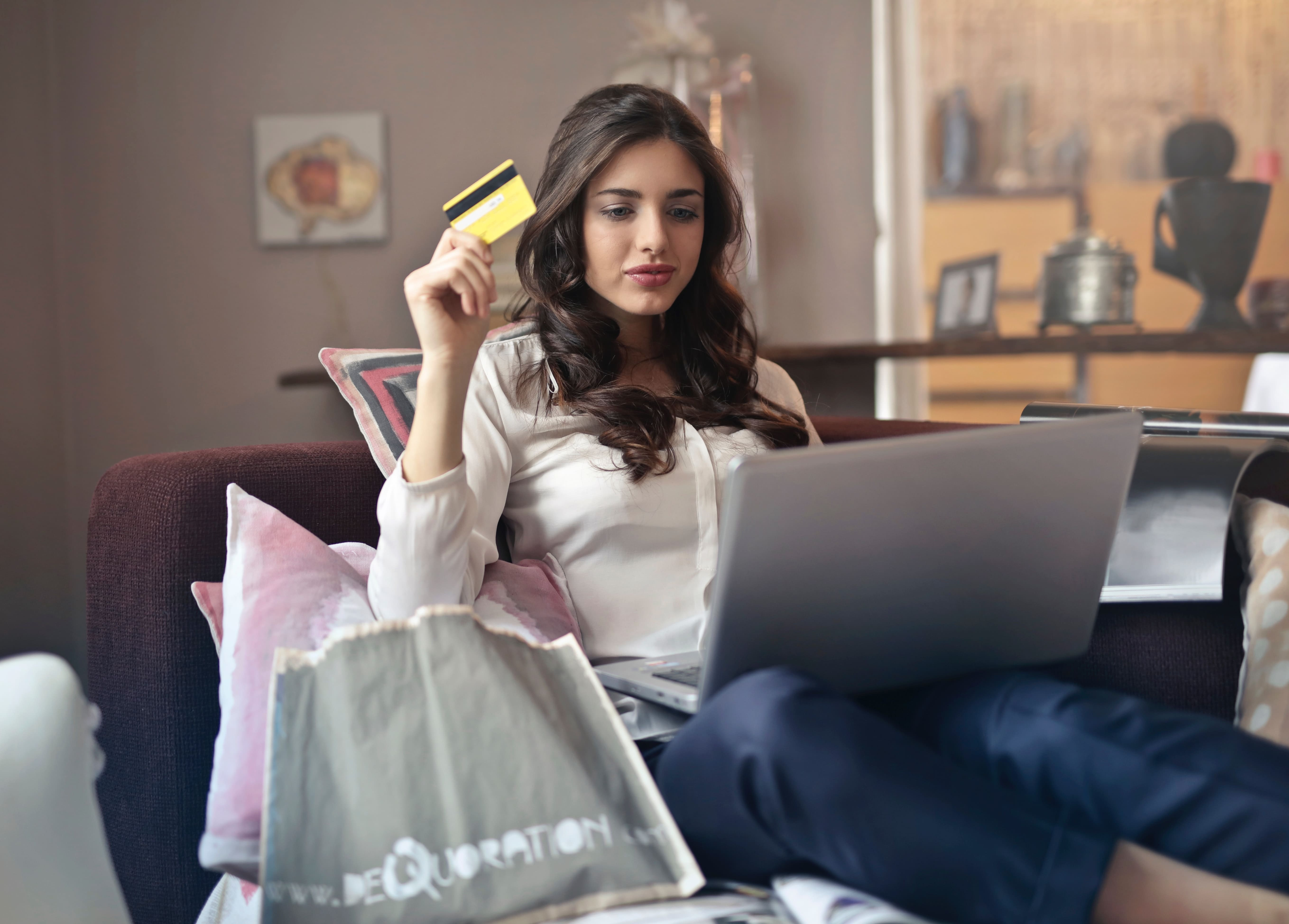 Woman On Laptop With Card In Hand